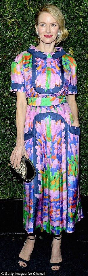 All things bright and beautiful: Nicole Kidman sported a cream satin peplum top while Naomi Watts wore a brightly coloured dress at theCharles Finch and Chanel pre-Oscar dinner