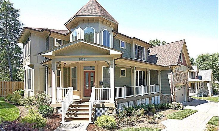 Modern victorian style green siding with beige trim red shingle accents and white windows for Exterior victorian house parts