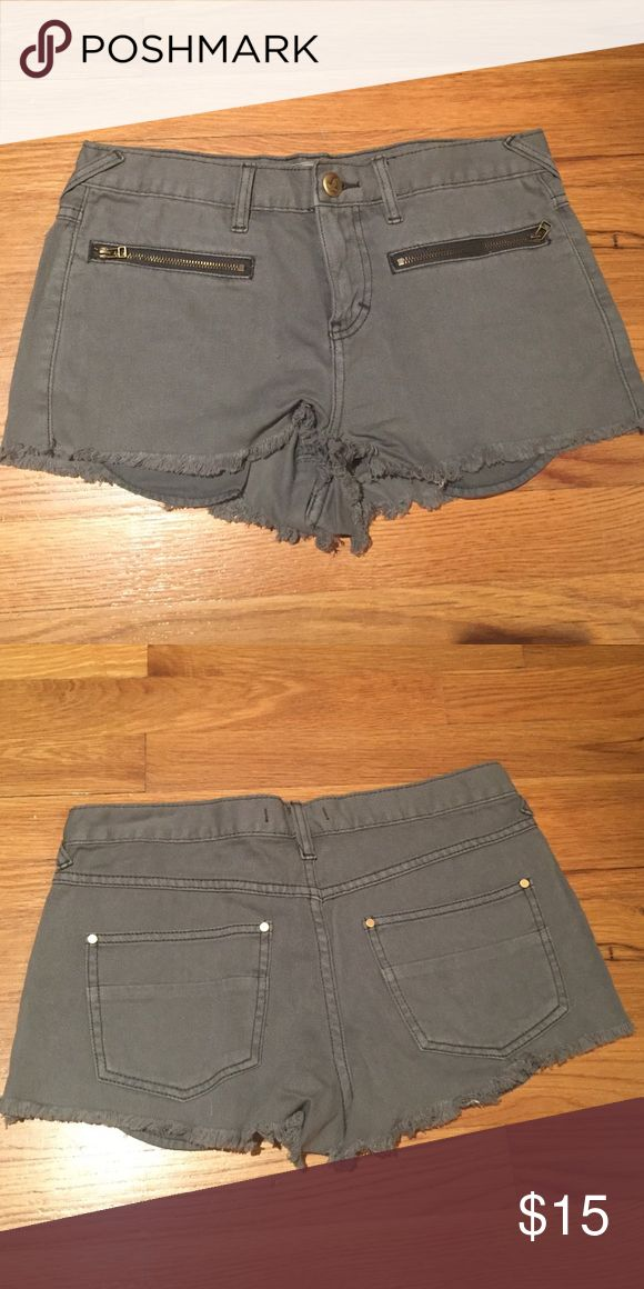 Free People denim shorts Grey low rise cutoff denim shorts with two front zip close pockets. Fraying/fringe on bottom. Free People Shorts Jean Shorts