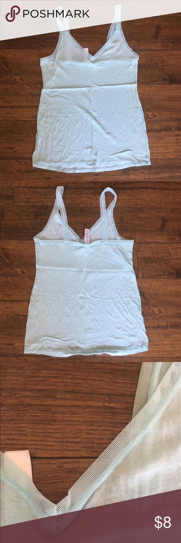 Light Blue Cami with Mesh Straps Light blue Cami with mesh straps. Very pretty. Size marked medium, but fits like a small. fine lines Tops Camisoles