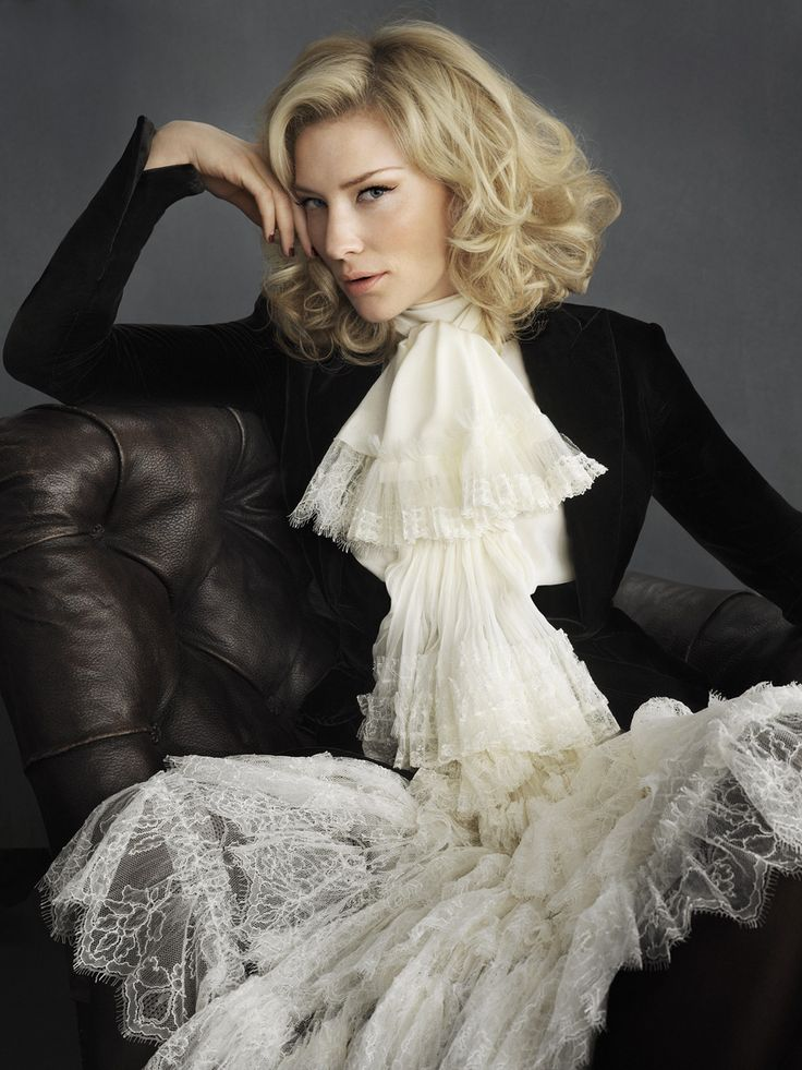 Cate Blanchett in a velvet jacket and jabot or 17th century cravatte, and what seems to be a matching lace skirt... Very New Romantic. Love the hair and eyeliner. Love Cate too.