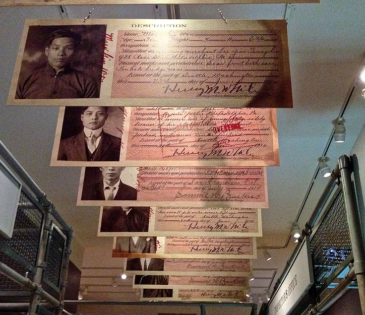 Beginning in 1892, persons of Chinese descent were required to carry photo identification cards.  Shown here are examples of some of those cards.  (The New York Historical Society Chinese Exclusion Act Exhibit.)