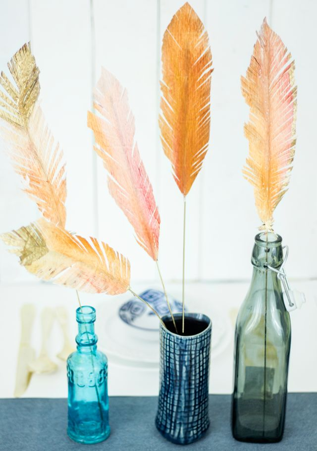 Fresh cut paper flowers feathers oh so beautiful