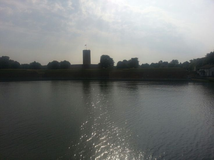 A backlit photo of the 13th century Twierdza Wisloujscie (Teutonic Knights fort) at the mouth of the Wisla river.