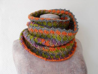 Crochet snood with the five colours  Green, grey, orange, natural and purple