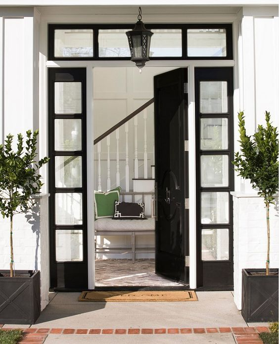 Front Door. Classic Black Solid Door. Glass Sidelights. Zinc Planters.