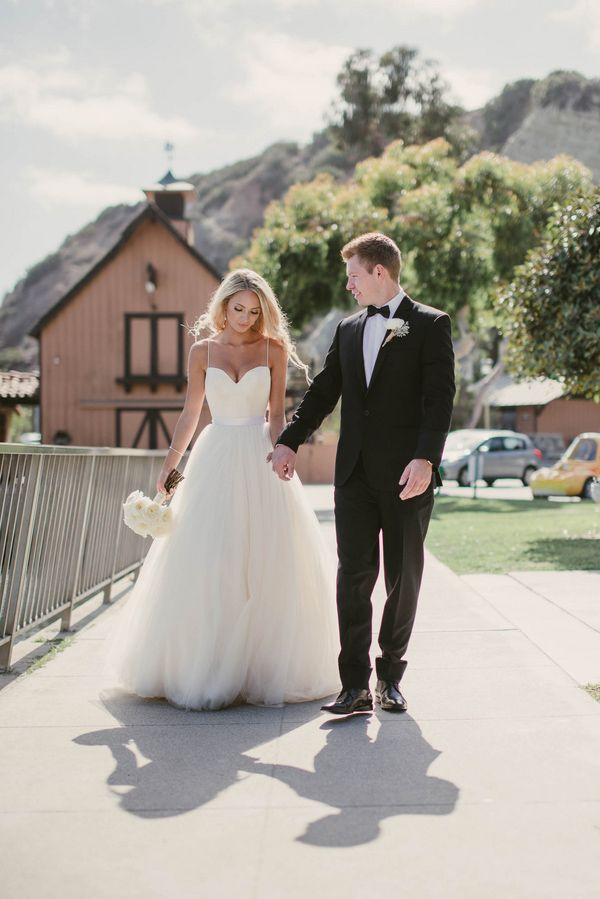 Strolling Hand in Hand | Vitaly M Photography | Black Tie Coastal Wedding with Classic Beach Details