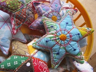 I love these stars. Pincushions? Xmas Decorations. Great use for small scraps of fabric!