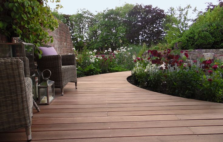 Cheshire Lakeside Garden using Yellow Balau Hardwood Decking from Silva Timber  http://www.silvatimber.co.uk/blog/case-study-cheshire-lakeside-garden-yellow-balau-hardwood-decking  Garden by Jo Willcocks