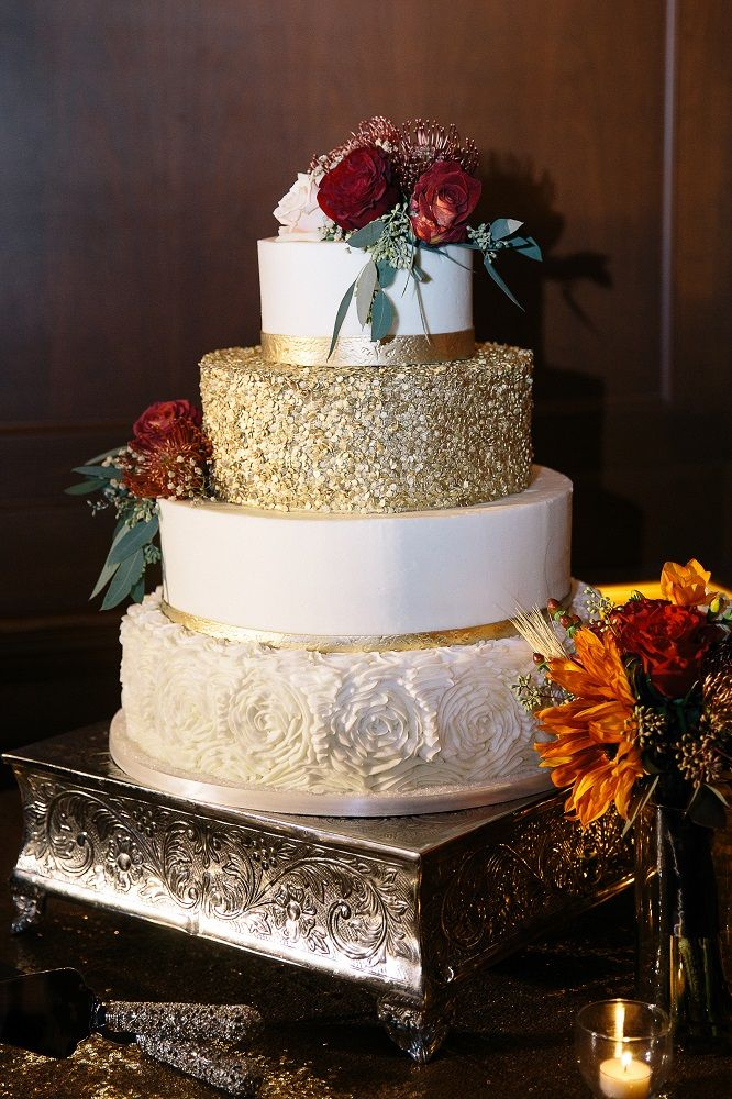 Four tier white and gold with glitter wedding cake and fresh fall flowers to put it all together | Brooke Photography | villasiena.cc
