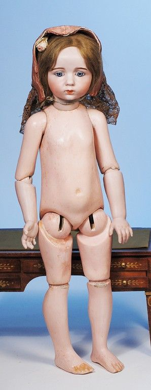 56: EXTREMELY RARE FRENCH BISQUE DOLL BY ALBERT MARQUE : Lot 56 Have a doll with joints like this. No other information