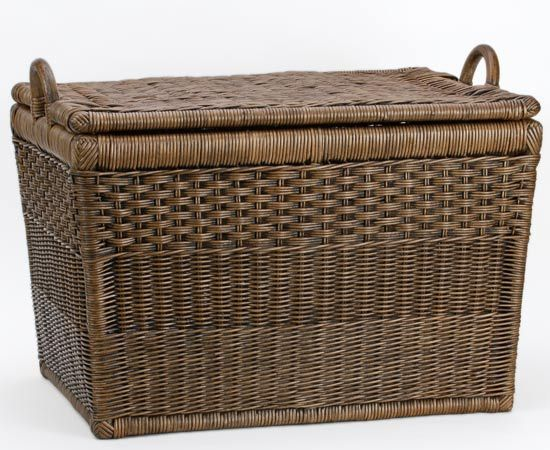 These baskets could really be called storage trunks with a lift-off lid. Each basket starts out as a pole frame, just like a piece of fine furniture. Then they are woven by our finest group of artisan weavers using three different weave styles. A wood bottom is securely attached for durability.   •Medium size is perfect for office organization and fits a hanging folder frame kit    •Includes removable cotton liner  •Available in 2 sizes  •Finished in Antique Walnut Brown and Simply Natural