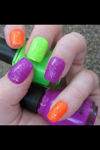 Green purple and orange nails plus sparkly