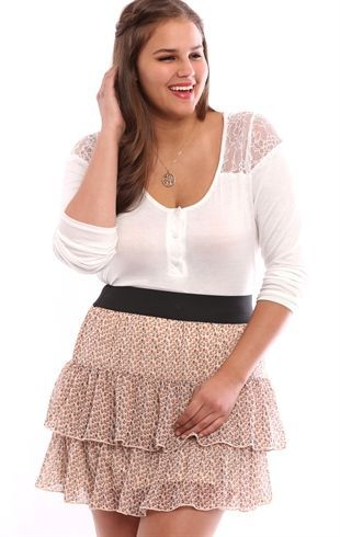 This plus size mini skirt features two tiers, a small floral print and an elastic waist. This pretty skirt is perfect with flats and a simple tee.