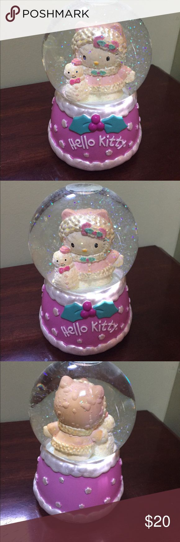 Hello kitty Christmas snow globe play music Adorable hello kitty snow globe in good displayed condition plays we wish you a merry Christmas- I do not have the original box but I will wrap carefully with a lot of bubble wrap Hello Kitty Accessories