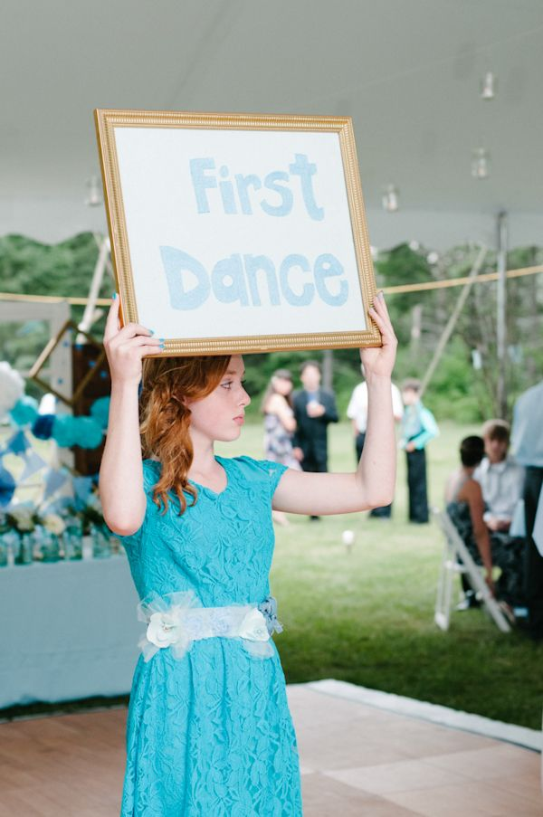 Holding up first dance sign.