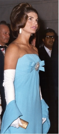Jackie - wearing an Oleg Cassini gown at a dinner in Mexico ...she's absolutely stunning!