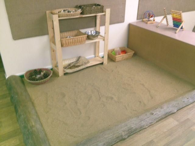 A large crawl in sand pit with natural resources for the babies to explore inside the classroom - Naturally Learning ≈≈