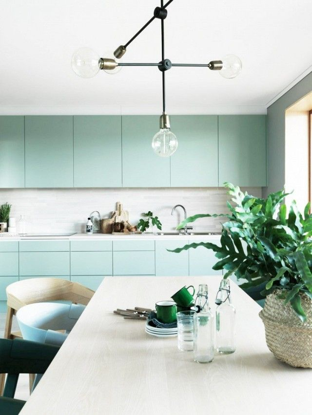 If you need some fresh inspiration in the kitchen, try switching out the typical beige cabinets for this crisp color. It's so inviting that you'll be counting down the workday hours...