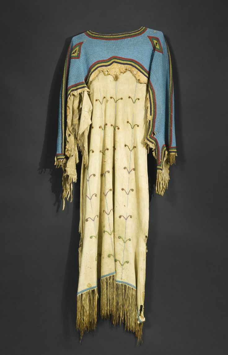 Sioux beaded and fringed hide dress with the yoke sewn in sinew and bright blue lazy-stitched glass beadwork, outlined in concentric bands of red, yellow, green and dark blue. Est $12K-$18K @ Sotheby's