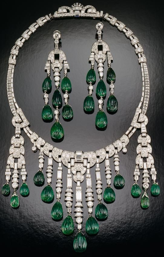 Emerald and diamond necklace - Designed by Ostertag; set with carved emeralds and diamonds in platinum; circa 1930. The longest dangle on the necklace and the earrings are each about 3 1/2 inches long.