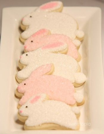 <3 Pastel chicken and bunny cookies covered in sparkly sanding sugar.  Plus marbeled eggs, piping, tips, and royal icing recipe.