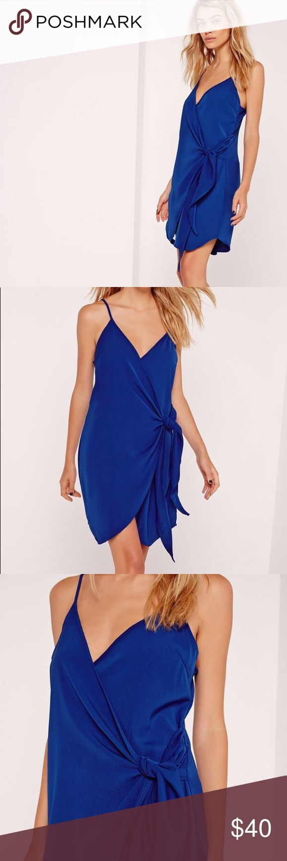 """Misguided Strappy Wrap Tie Waist Dress Cobalt Blue US SIZE 6 *BRAND NEW NEVER WORN WITH TAGS!!!*  This season has been awash with royal blue and this dress is one not to miss. Featuring a cobalt blue for an instant pop of colour, adjustable cami straps and a tie waist to pull in your curves. This shift dress can be dressed up or down. Team with black heeled boots and a jacket for a smart cas' look. Approx length 90cm/35"""" (based on a uk size 8 sample)   95% polyester 5% elastane  Model wears…"""