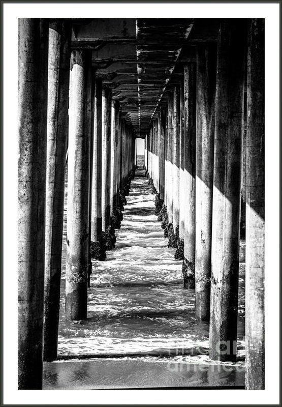 Under huntington beach pier black and white picture framed print by paul velgos