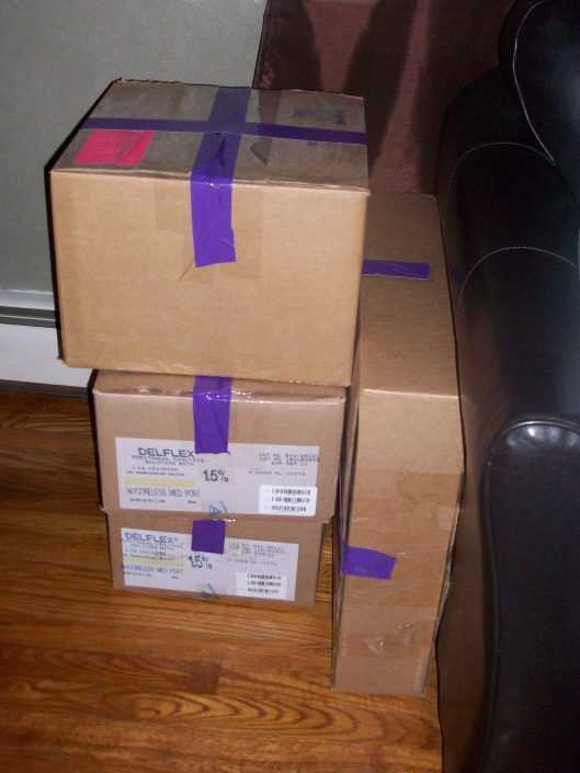 Moving tips -- different color duct tape for different rooms... Mark UNPACK First on 1 box per room :)