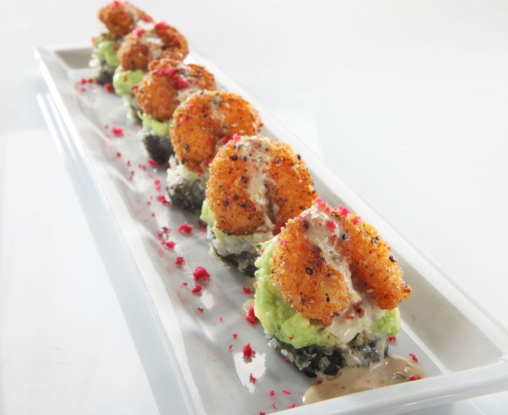 "RACKin Roll (RA Sushi) - Kani kama crab & cream cheese rolled in rice & seaweed, lightly tempura battered & topped with guacamole & ""RA""ckin' Shrimp; finished with a creamy ginger teriyaki sauce, red beet tempura bits & togarashi"