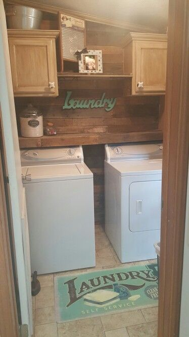 Pallet wood laundry room, antique painted and glazed cabinets (kit from home depot) and hobby lobby decor.