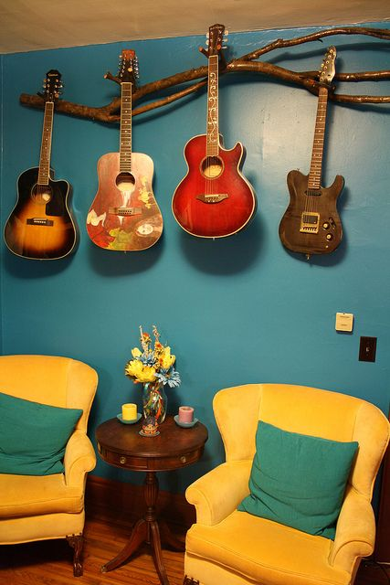Never thought of a guitar rack but one of some sort would be good for our music room to get all Nathan's guitars off the floor.