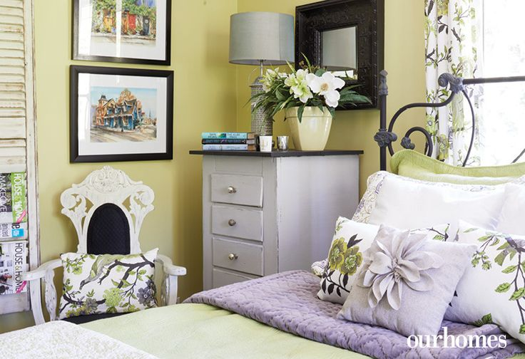 """Who wouldn't want to be the guest in this bedroom? It's a perfect pairing of lavender accents with soft green walls in Benjamin Moore's Pale Avocado.     See more of this home in """"Elora Homeowners Add Character in Spades"""" from OUR HOMES Wellington-Dufferin Summer 2017: http://www.ourhomes.ca/articles/build/article/elora-homeowners-add-character-in-spades"""