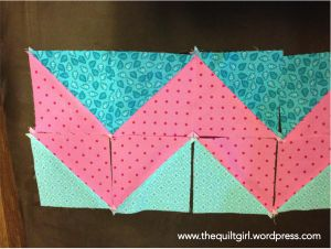 Bright quilt in pieces, ready to be sewn together