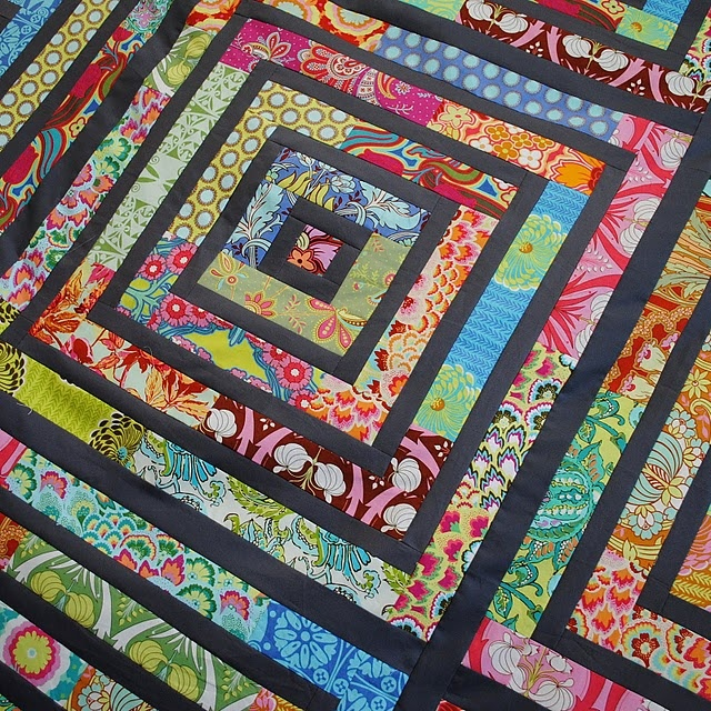 Challenge yourself with a jelly roll quilt that combines strip quilting and making quilt blocks. The results are hypnotizing and artistic without being too overbearing.