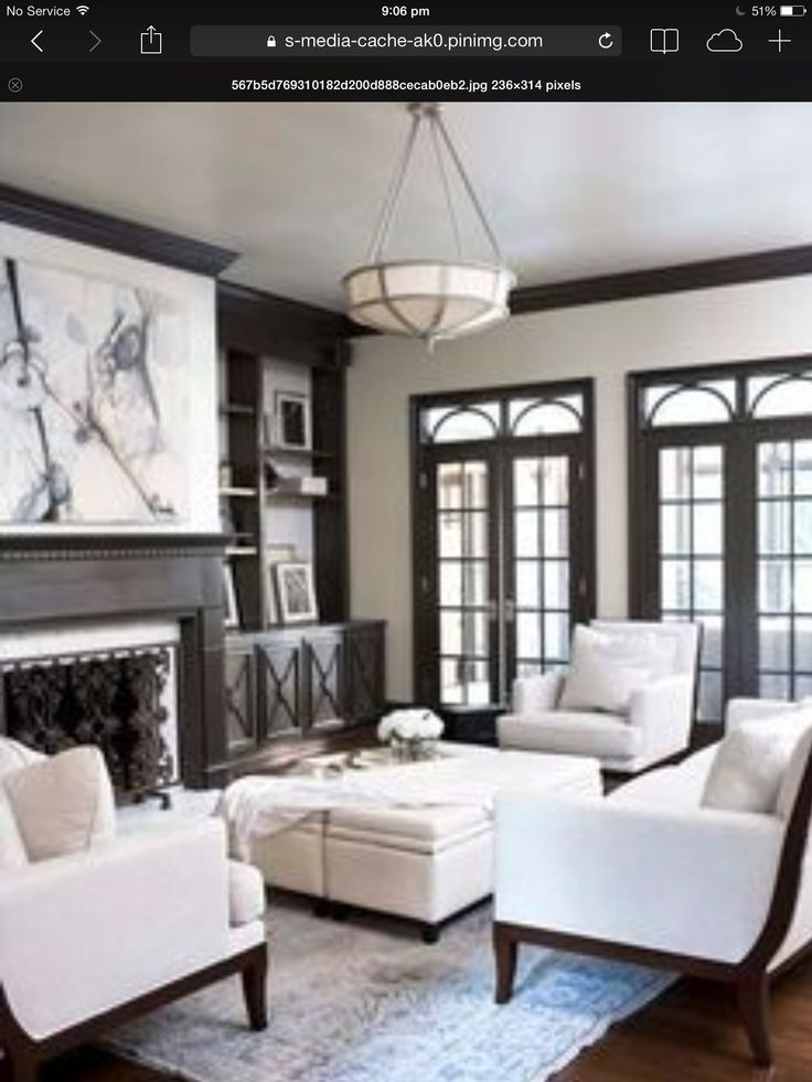 Taupe Walls Black Windows Dark Wood Flooring Living Room