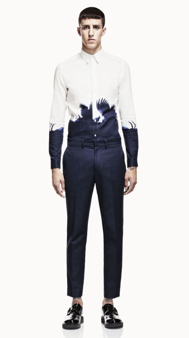 Alexander McQueen - Don't you just love the contrast between the dark blue and the white, especially w/ those feathered details!