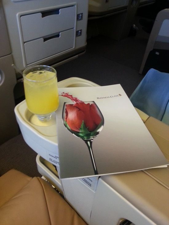 "Inflight cocktail - Silver Kris Sling, which is delicious mix of gin, cointreau, orange juice and pineapple juice topped with champagne (Singapore Airlines ""Book the Cook"")"