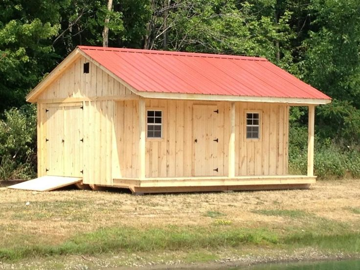 10' x 18' shed with 4' porch, metal roof, windows and extra door. Handmade by Amish, delivered.