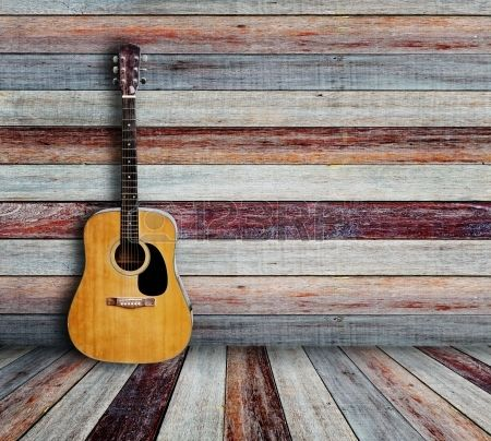 Guitar and picture frame in vintage wood room  Stock Photo