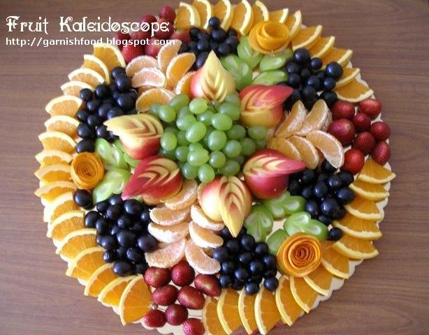 Fruit Carving Display   with nectarine garnishes apple leave garnishes and orang roses ...