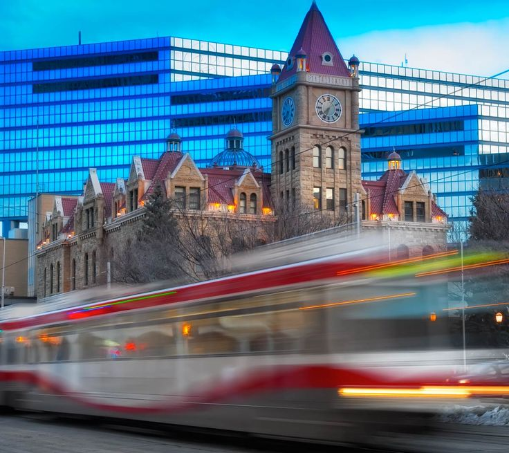 C-Train going past the old City Hall with the New City Hall in the background.