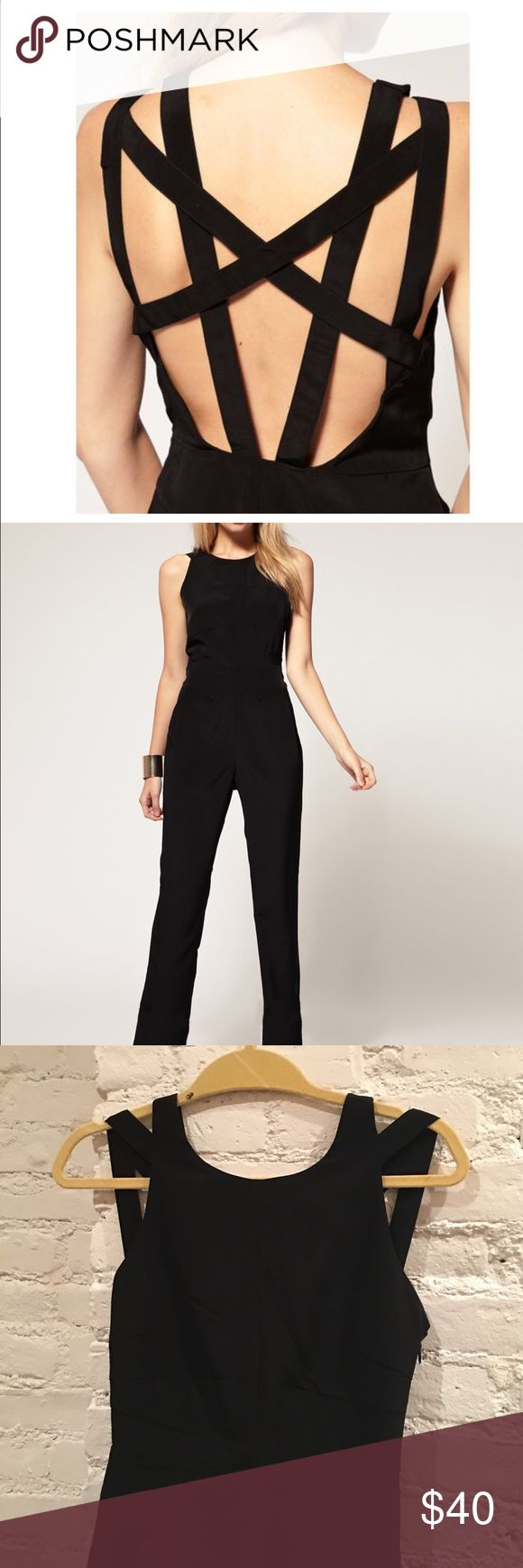 MAKE OFFER! Asos Petite jumpsuit with cross back Chic black Asos Petite exlusive jumpsuit with cross back. Side zip closure. So stylish! ASOS Petite Pants Jumpsuits & Rompers