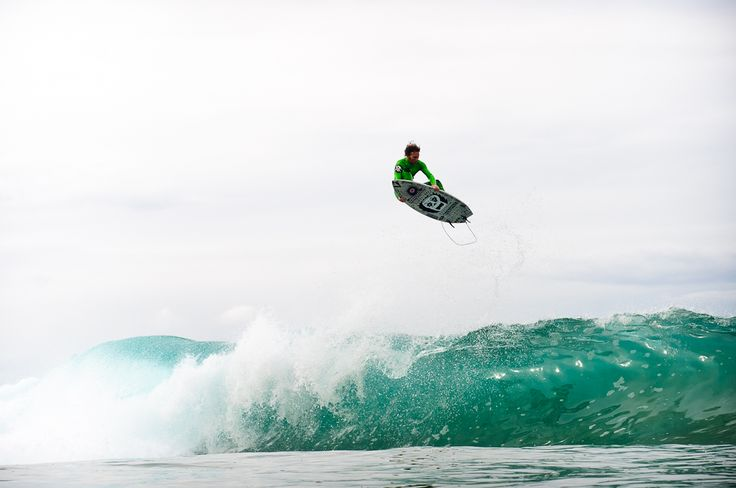 Ozzie Wright punting at Whale Beach, Sydney.