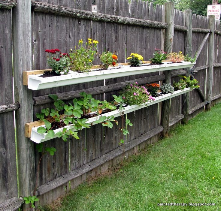 gutter garden probably easier than a pallet hanging garden but definitely not cheaper