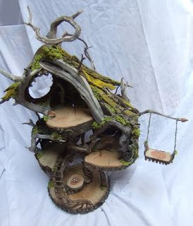 Woodland Fairy House. I like the swing.