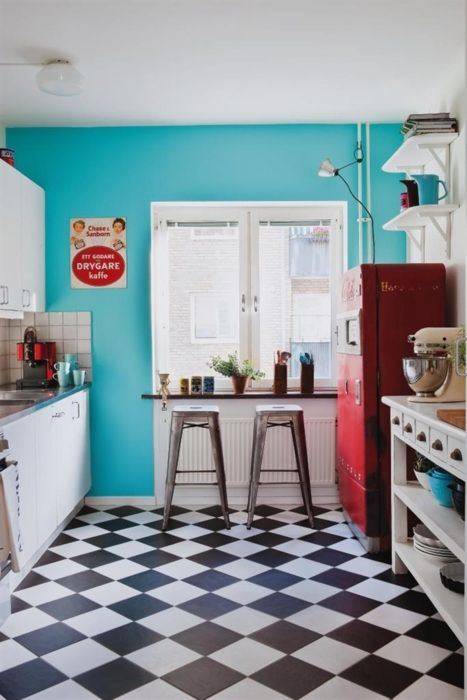how gorgeous! Tiffany blue wall, a hot red retro fridge, Tolix stools and that floor!