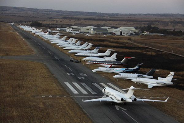 One plane in runway and others on the side in Johannesburg Airport, South Africa.