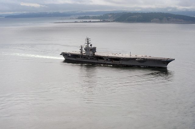 OAK HARBOR, Wash. (June 13, 2014) The aircraft carrier USS Nimitz (CVN 68) cruises in the Strait of Juan de Fuca. Nimitz is underway hosting friends and family day, an event where nearly 400 civilian guests joined the ship's crew for a special one-day underway. (U.S. Navy photo by Mass Communication Specialist 2nd Class John Hetherington)