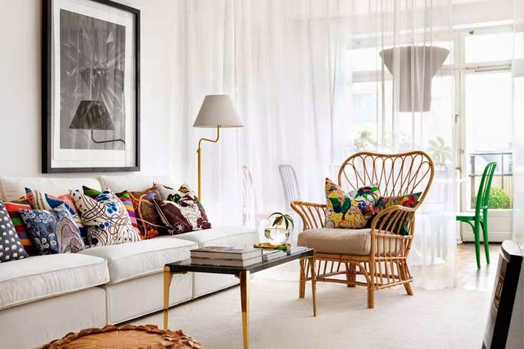 great rattan chair and I like how they partitioned off the dining area with a sheer curtain which lets the light through but creates some separation.